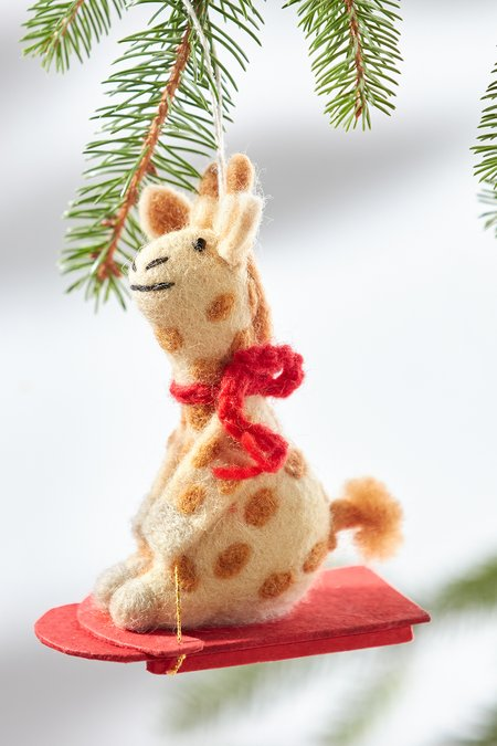Sledding Ginger the Giraffe Ornament